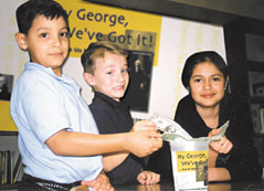 "Ismael Rosas, Charles Rhinehart, and Marielly Garza (left to right) from Sparks Elementary School in Pasadena, Texas catch the spirit and contribute to the ""By George We've Got it Campaign"" campaign."